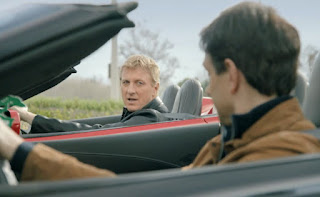 Stacie's husband driving a car along with her co-star