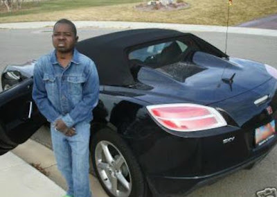 Gary Coleman standing side of his car