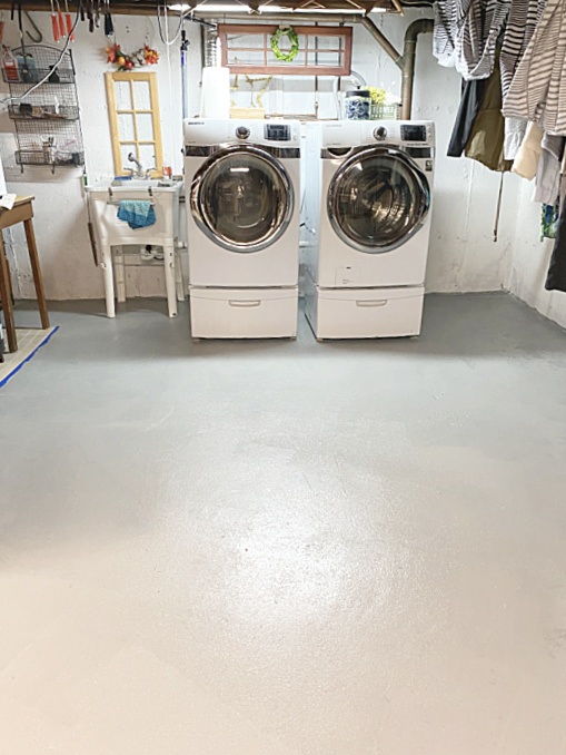 painted basement floor and washer and dryer