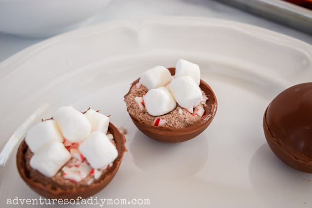 hot chocolate bomb shells filled with cocoa mix, crushed candy canes and small marshmallows