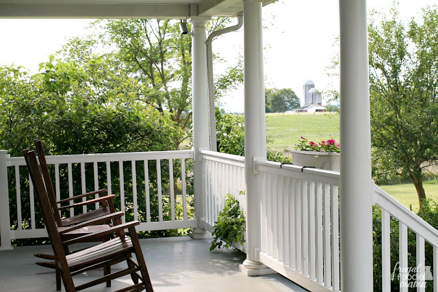 The large front porch at the Farmhouse at Hillbrook Inn & Spa is equipped with wooden rocking chairs perfect for relaxing in and taking in the beautiful views of the surrounding farms and the apple orchard.