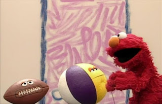 Elmo, beach ball and football appear in the same scene. Elmo's World Balls Interview
