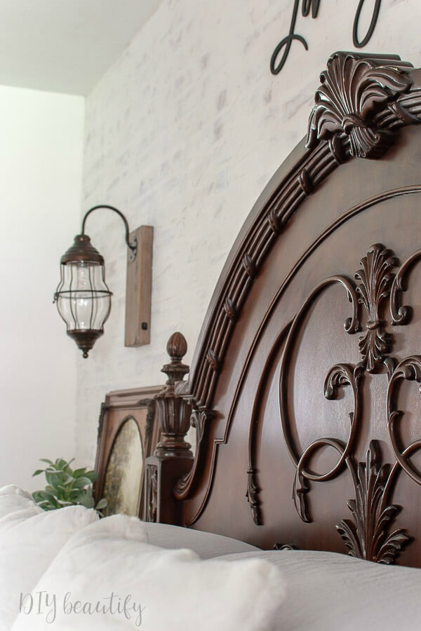 dark arched headboard with carvings