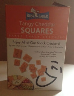 A poorly-lit box of Busy Baker Tangy Cheddar Squares, from Dollar Tree
