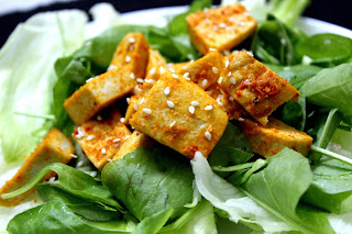 tofu marinated in red chilli paste and baked