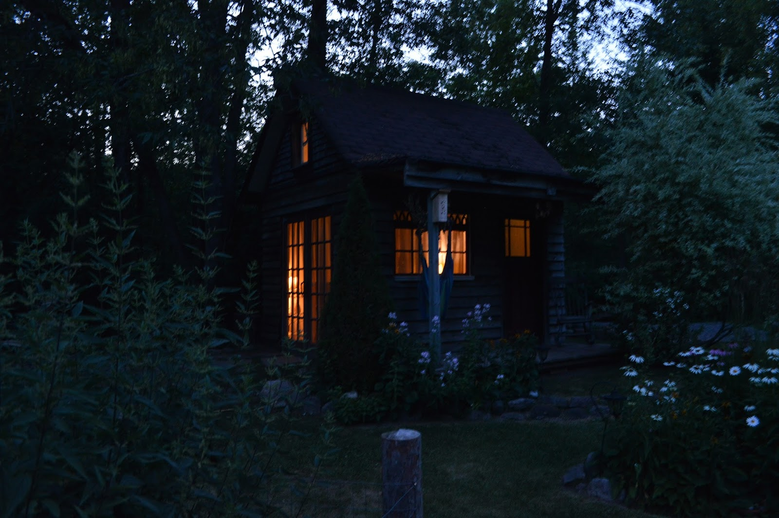 We Left The Lights On In Cottage Other Night And As Sun Set It Stood Glowing Our Backyard Exuding Beauty Peace