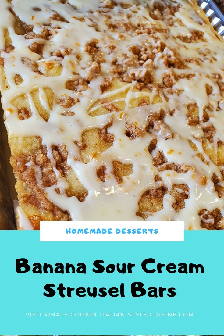 pin for later banana sour cream bars with a streusel topping and orange zested frosting in the an aluminum pan