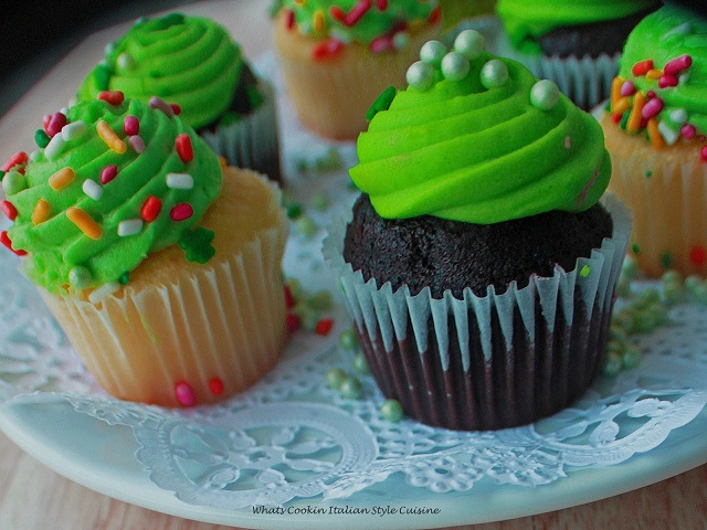 St PAtrick's Day Chocolate stout cupcakes with green frosting and vanilla on a plate