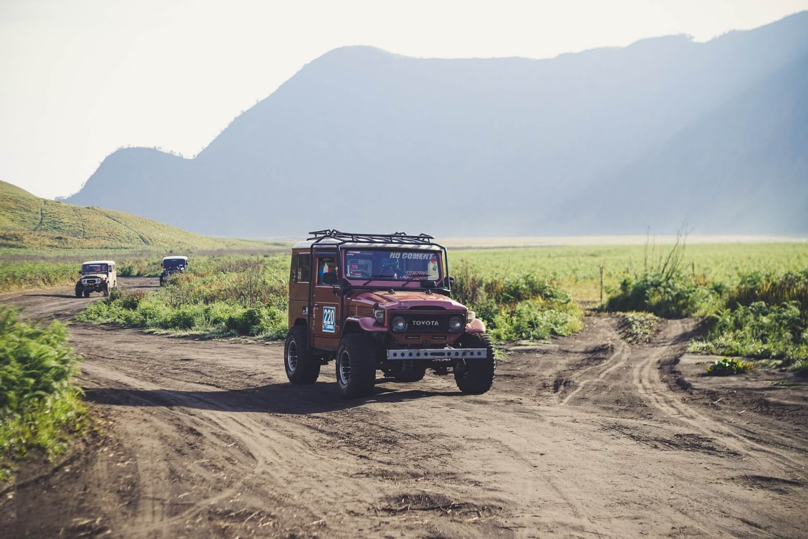 Toyota jeeps, off-roading , three toyota jeeps traveling on a gravel road