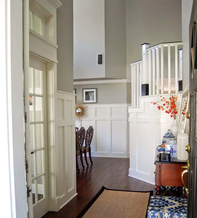 French doors enclosing home office and dining chairs