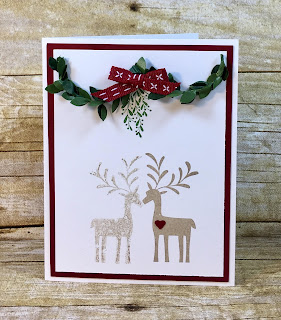 "This Christmas card uses Stampin' Up!'s Merry Mistletoe stamp set along with the Boxwood Wreaths and the Cherry Cobbler 1/4"" Double Stitched Ribbon.  It uses the reflection technique so the deer are kissing.  Instructions and reflection vidoe on the blog!  #stamptherapist #stampinup www.stamptherapist.com"