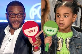 Tyler Perry and Blue Ivy Carter at an Auction