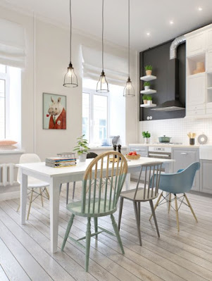 Nifty Scandinavian dining room with white dining table and mix matched dining chairs also love the pendant lights