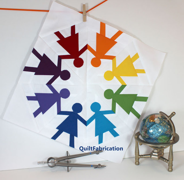 8 rainbow colored paper dolls in a quilt block