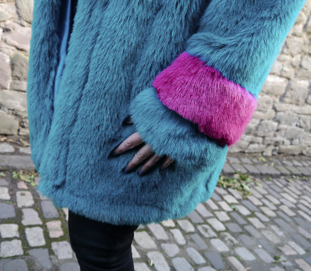 details of turquoise faux fur jacket texture