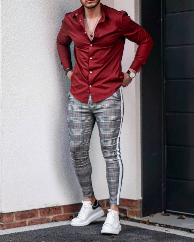 Maroon shirt and grey patterned trousers
