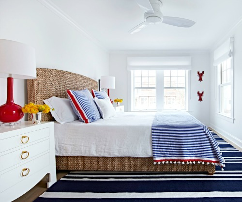 Coastal Bedroom with Red Decor Accents