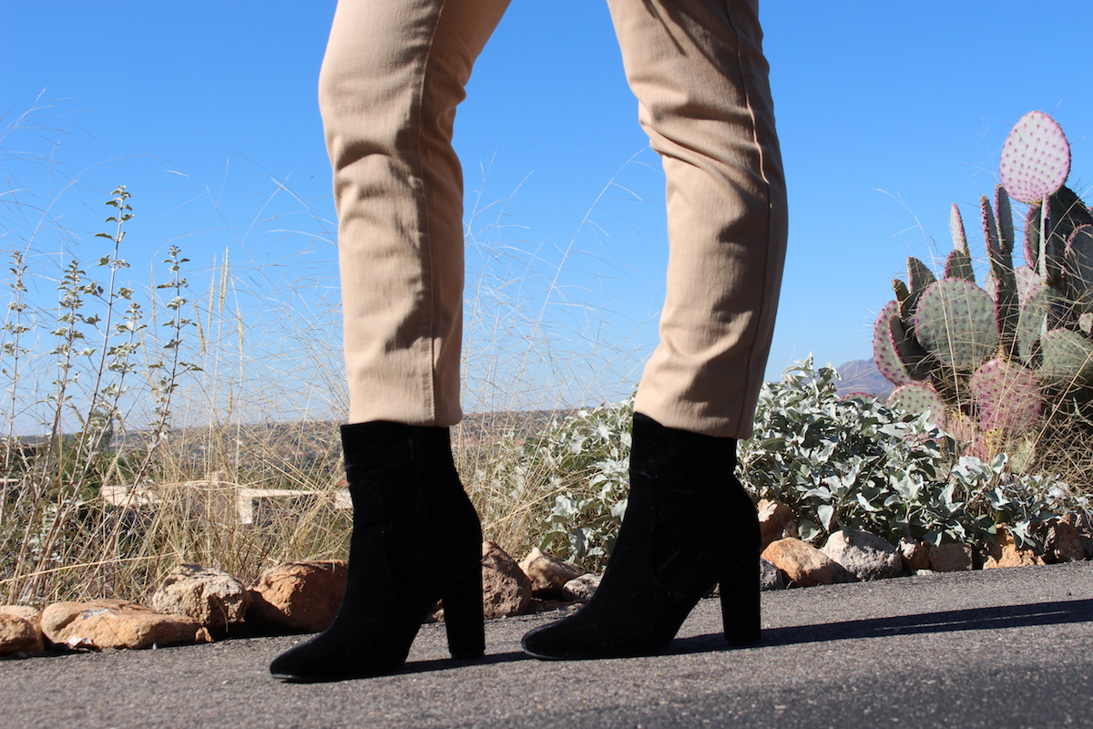 This is a close-up of my black velvet ankle boots, with the desert in the background.