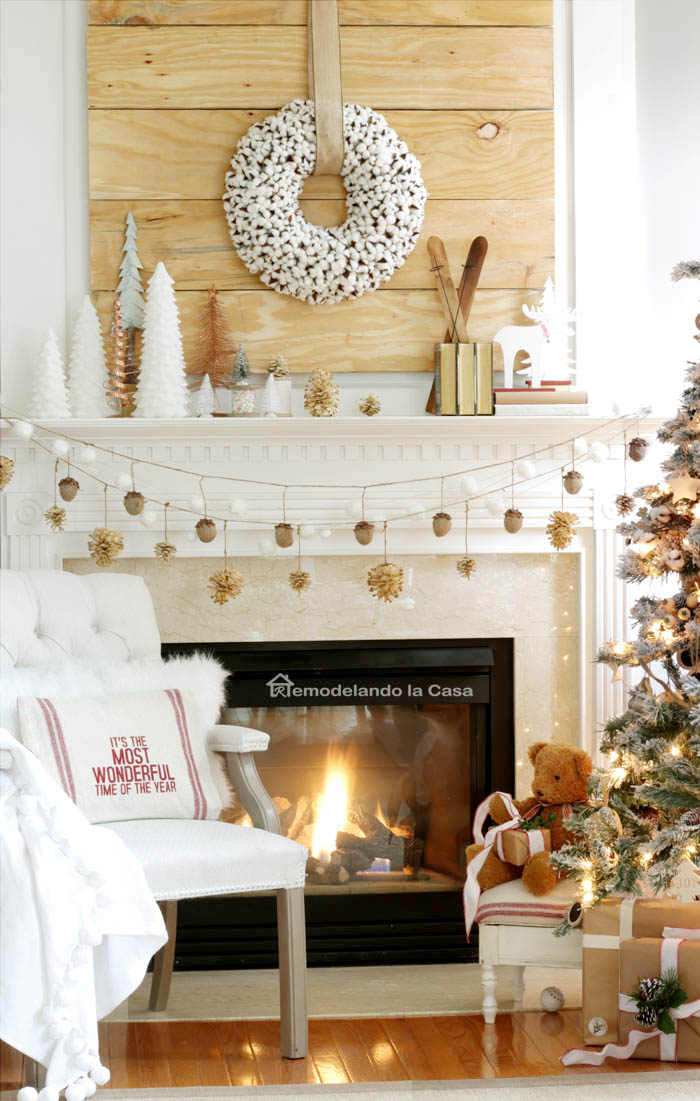 wooden palette, little trees,  It's the most wonderful time of the year pillow on chair, teddy bear close to christmas tree