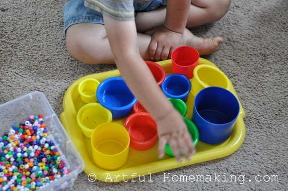 Fine Motor Coordination: Keeping Little Ones Hands Busy. Stacking cups and pony beads