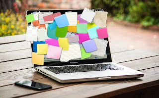 With many sticky notes, a laptop, but an available Smart phone is here