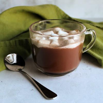 small glass mug with hot cocoa and mini marshmallows