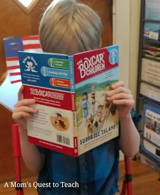 child reading Surprise Island
