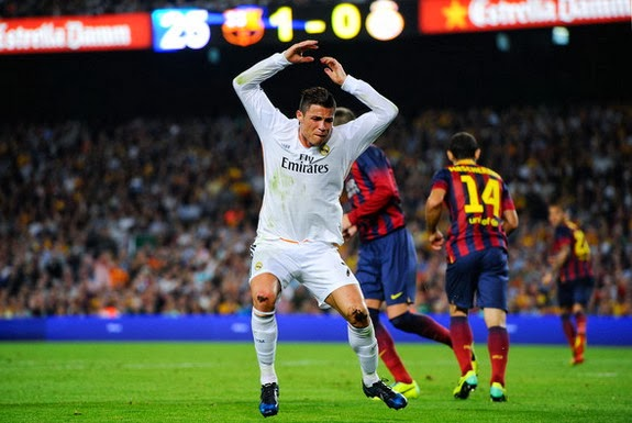 Real Madrid forward Cristiano Ronaldo reacts after being denied a penalty against Barcelona