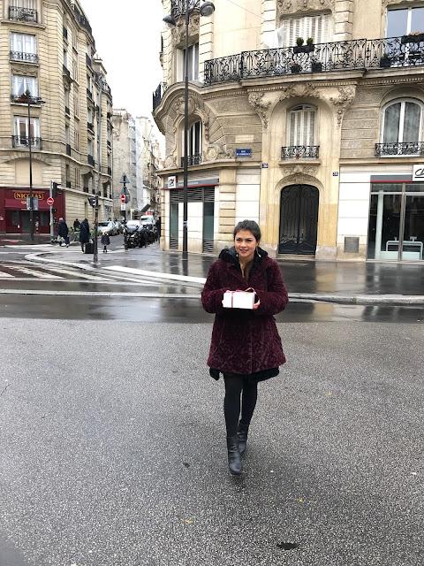 Kelly Fountain wearing Dennis Basso fur coat near the Eiffel Tower boulangerie in Paris
