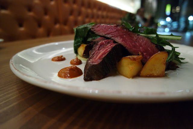 Hangar steak, fingerlings, hominy, manchego crisp, jammy tomato vinaigrette, local greens from Bodega Tavern & Kitchen