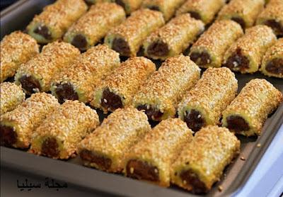 حلويات العيد : طريقة عمل حلوة أصابع التمر بالسمسم