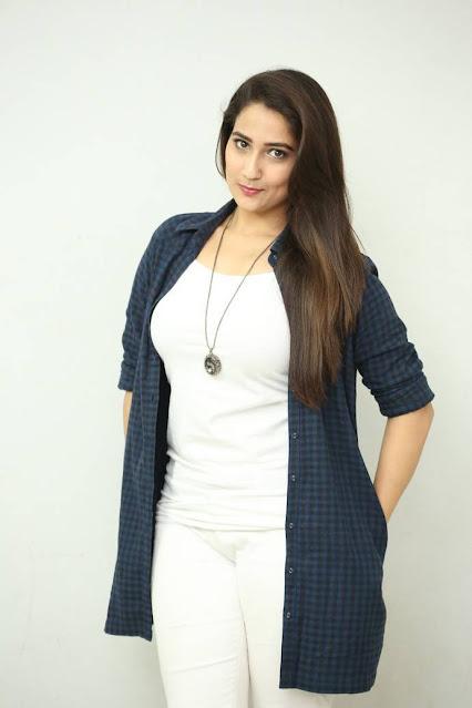 TV Anchor Manjusha Photos In White Top Tight Jeans https://www.actressbuzz.com