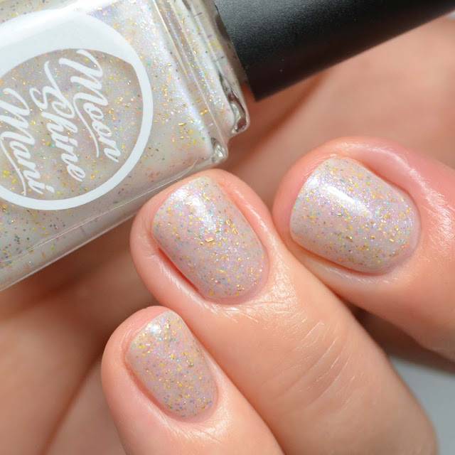 off white nail polish with sparkles and color shifting flakies swatch