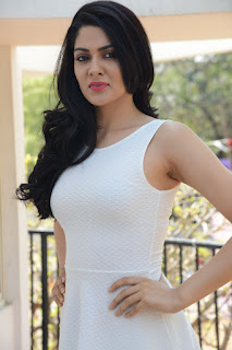Sakshi Chowdary Stills in White Short Dress at Lord Shiva Creations New Movie Launch ~ Celebs Next