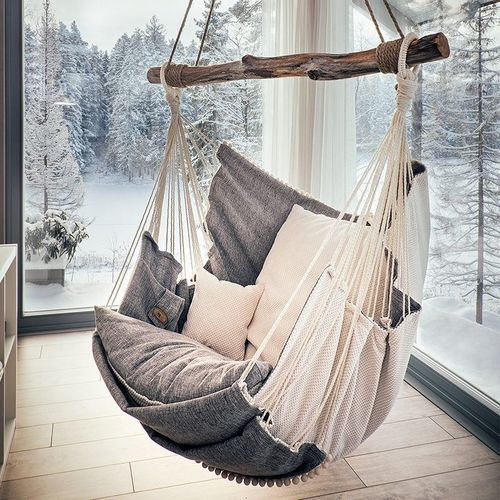 Cosy hanging chair with snow scape background