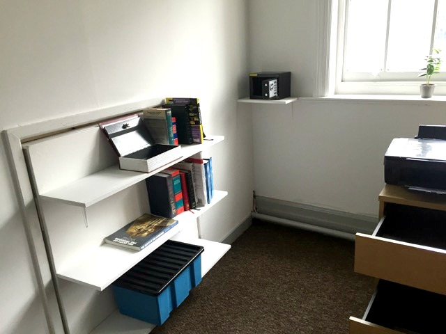Cryptology Nottingham Review | Morgan's Milieu: An office room drawers open, safe opened, books on shelf.