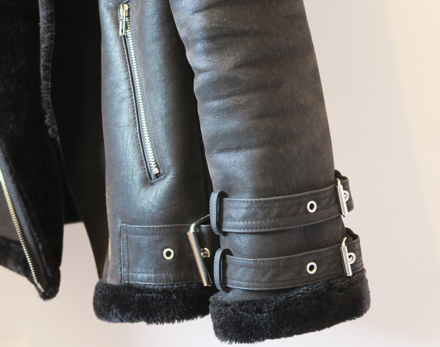 black shearling biker jacket buckles
