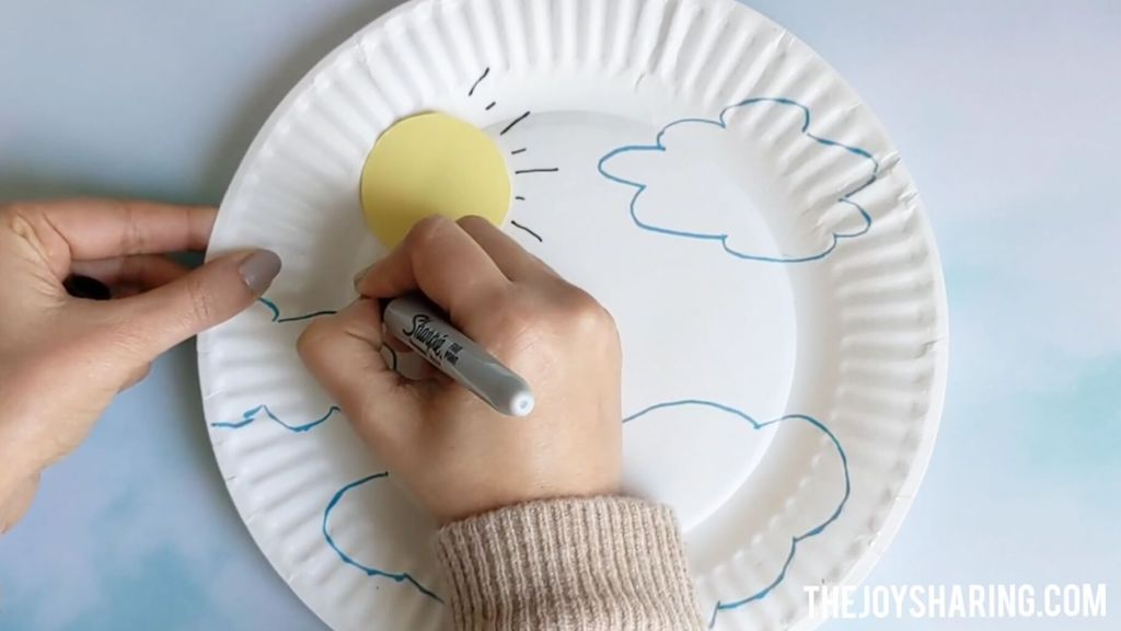 Drawing the sun for rainbow craft