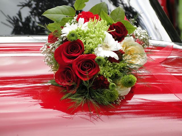 Wedding flowers on red 1957  Pontiac