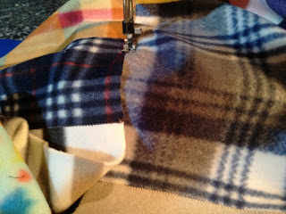Sew fleeces fabric stripes together for patchwork blanket Craftrebella