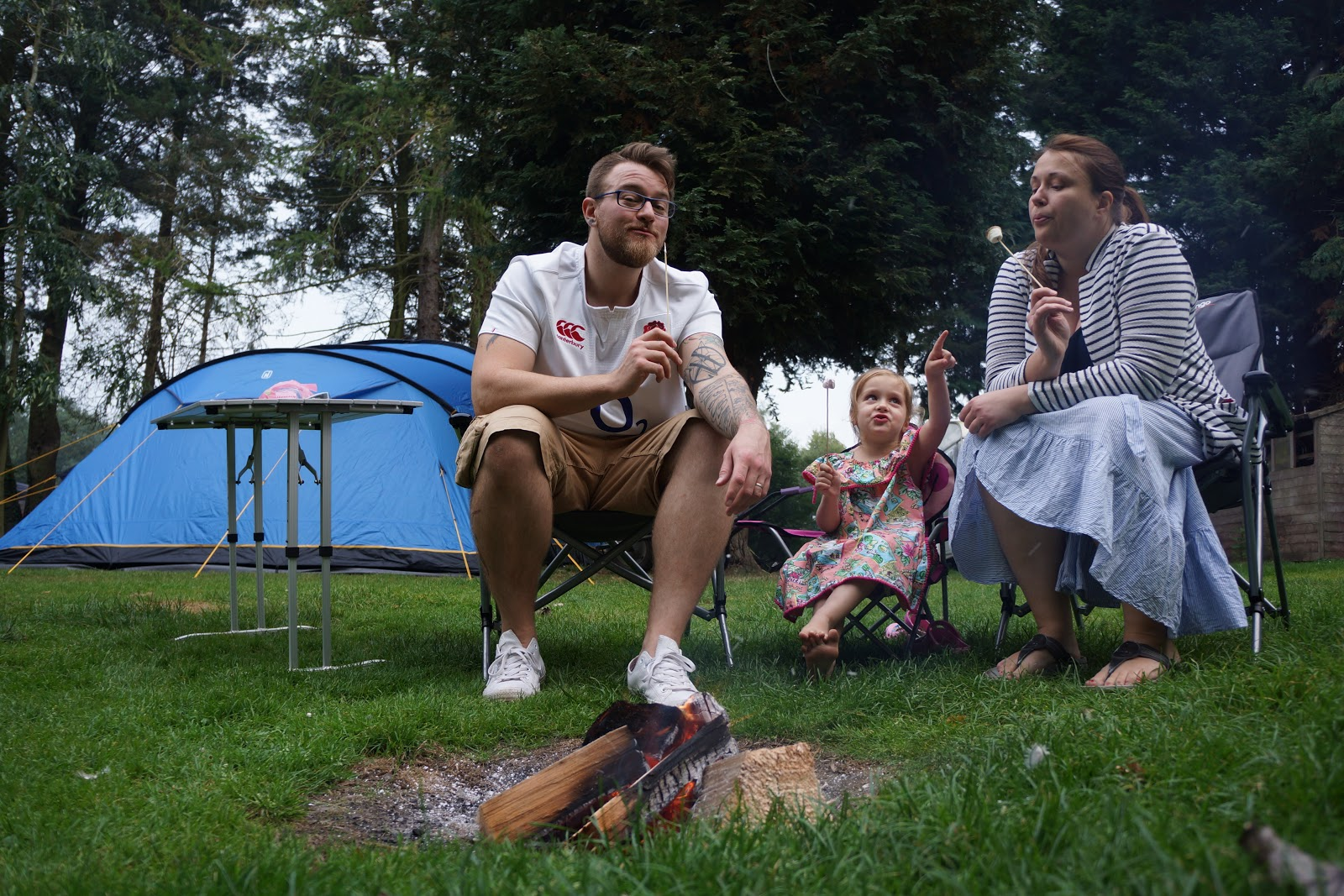 family eating toasted marshmallows