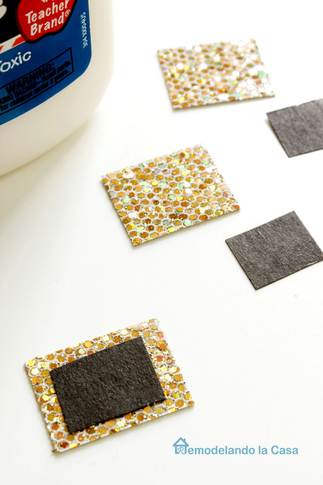 gold decorative paper with black to create belt for hat