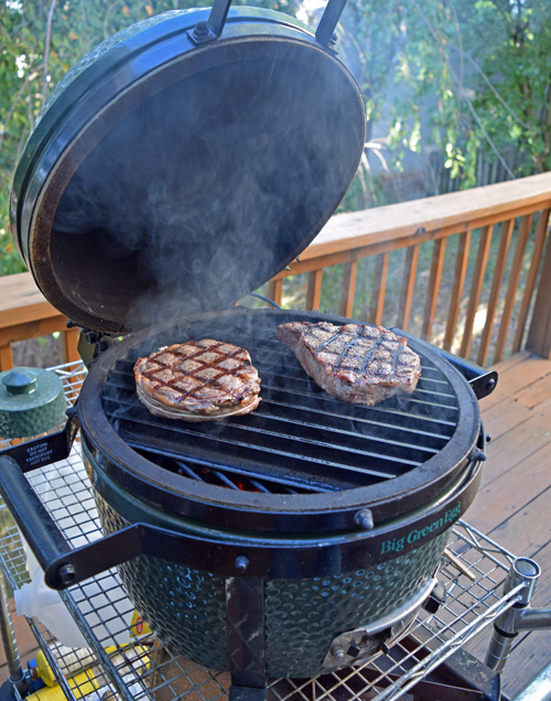 Certified Angus Beef Ribeye Steaks cooking on a Big Green Egg Mini-Max.