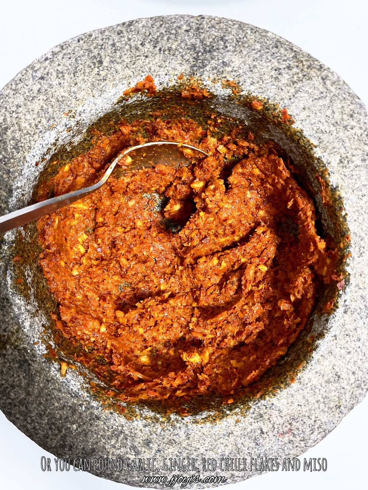 pound spices into paste with mortar