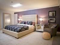 Bedroom accent wall with shade of purple from lighting