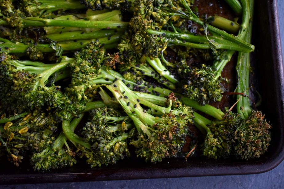 Asian Roasted Broccoli is roasted to perfect crispiness and tossed with soy sauce, garlic and a dash of vinegar! www.nutritionistreviews.com