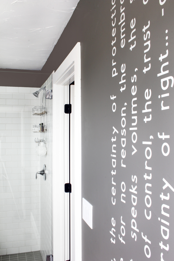 Bathroom white subway tile gray walls Cricut wall quote