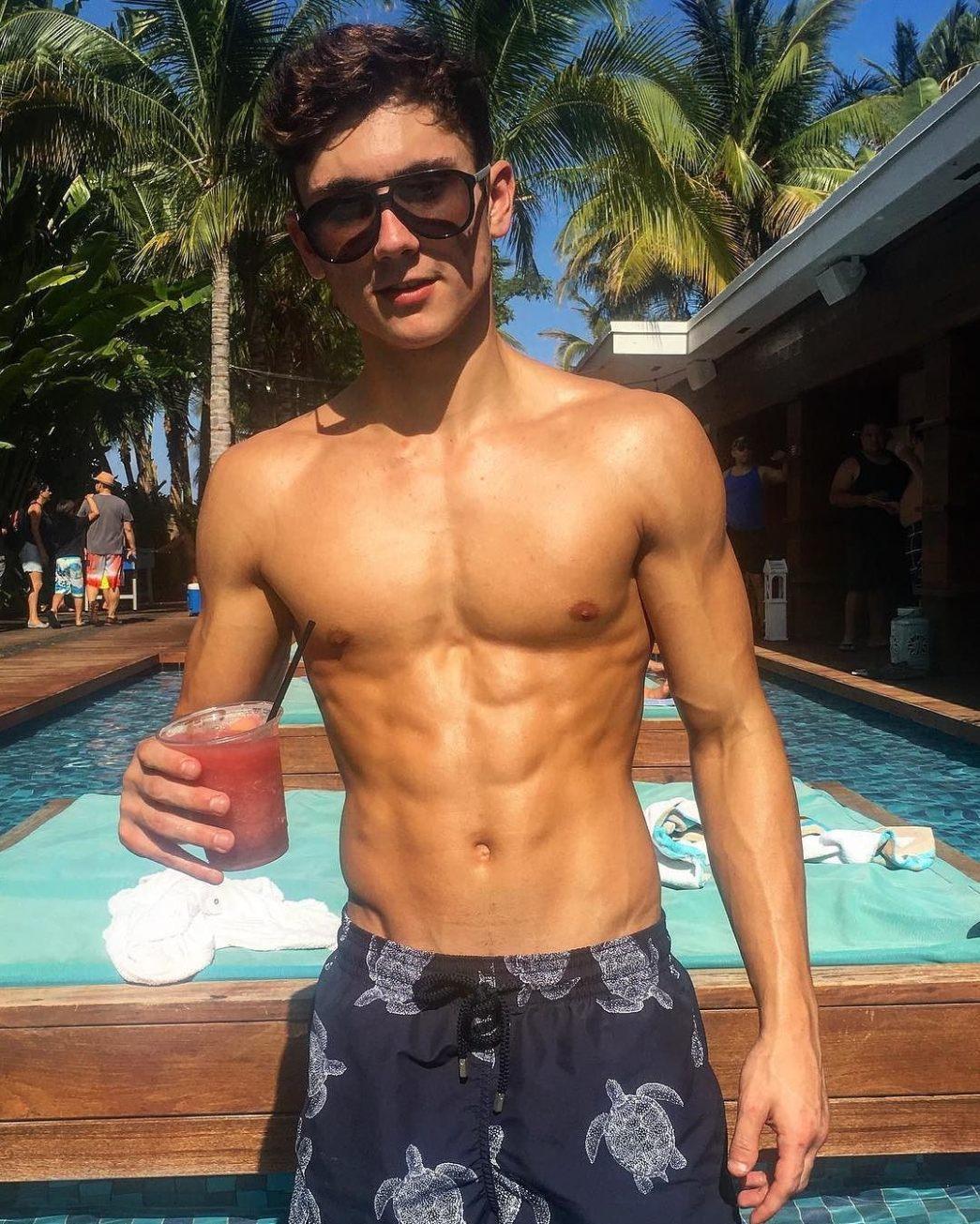 cute-american-korean-mixed-shirtless-slim-fit-boy-drinking-sunglasses-pool