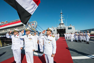 Egyptian Navy top officers saluting the flag during the commissioning of a GOWIND 2000 Corvette