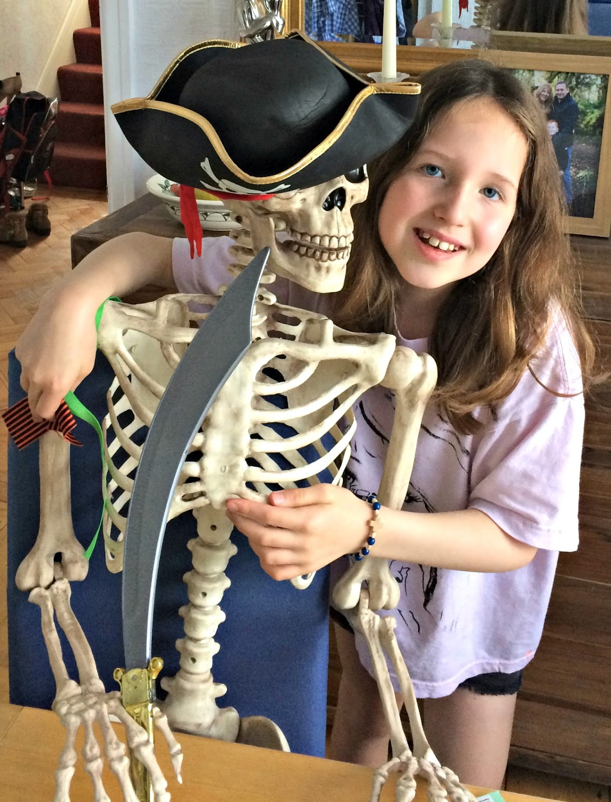 picture hanging solutions - Caitlin and Mr Bones the skeleton dressed as a pirate